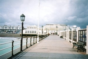 England-West-Sussex-Worthing-pier-view-to-shore-also-storm-iron-railings-and-lampposts-blue-aqua-tweaked-2-DHD